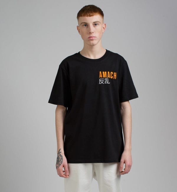 AMACH Cobain Kids' Relaxed Fit Organic Black Tee - model Leon - Front